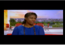 Electric blue dress adds sparkle to TV interview